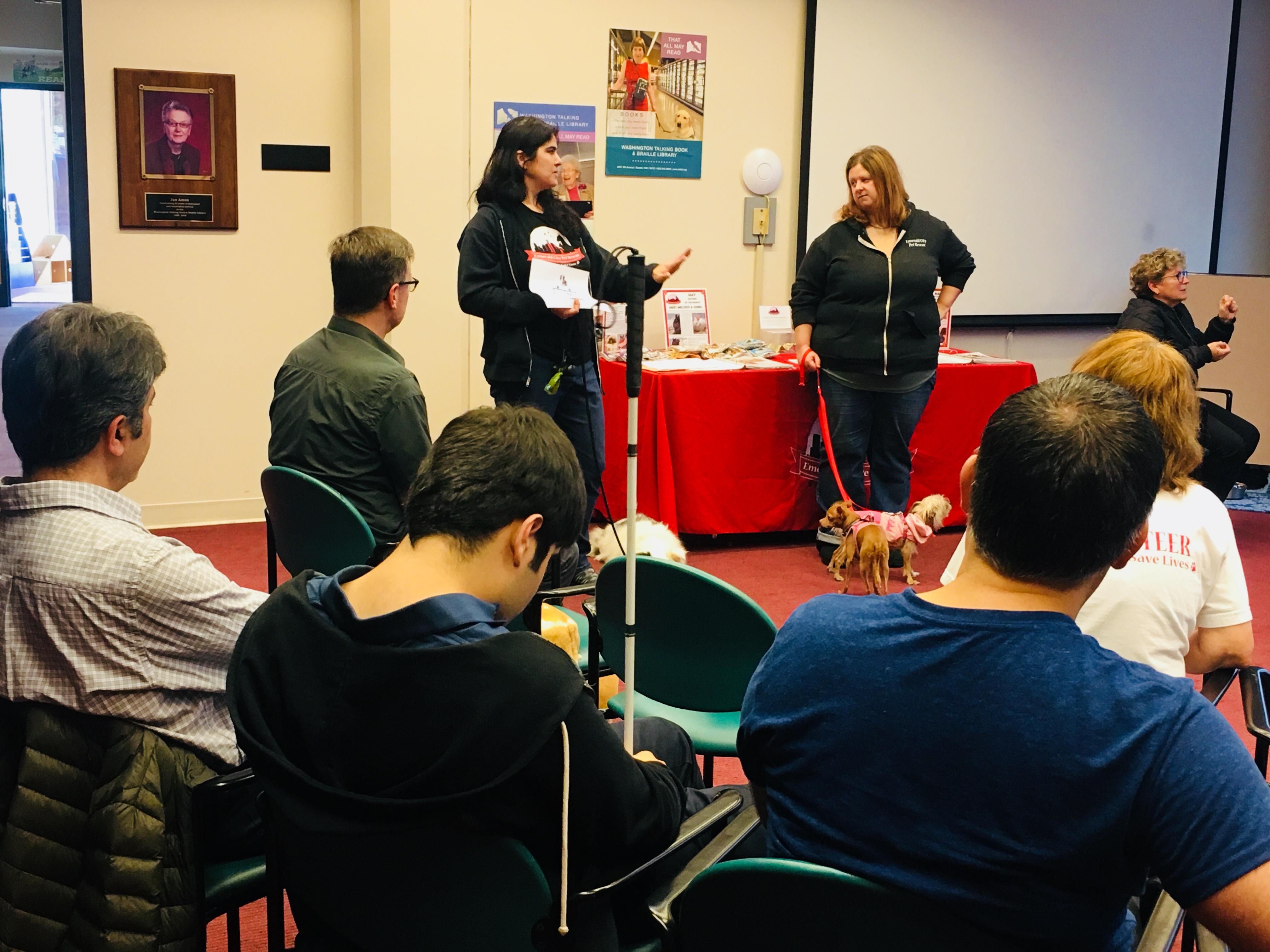 Emerald City Pet Rescue representative Bethany Black delivers a presentation about the care and rescue of animals with special needs to guests at the Special Pet Meet & Greet Event on May 5, 2018.