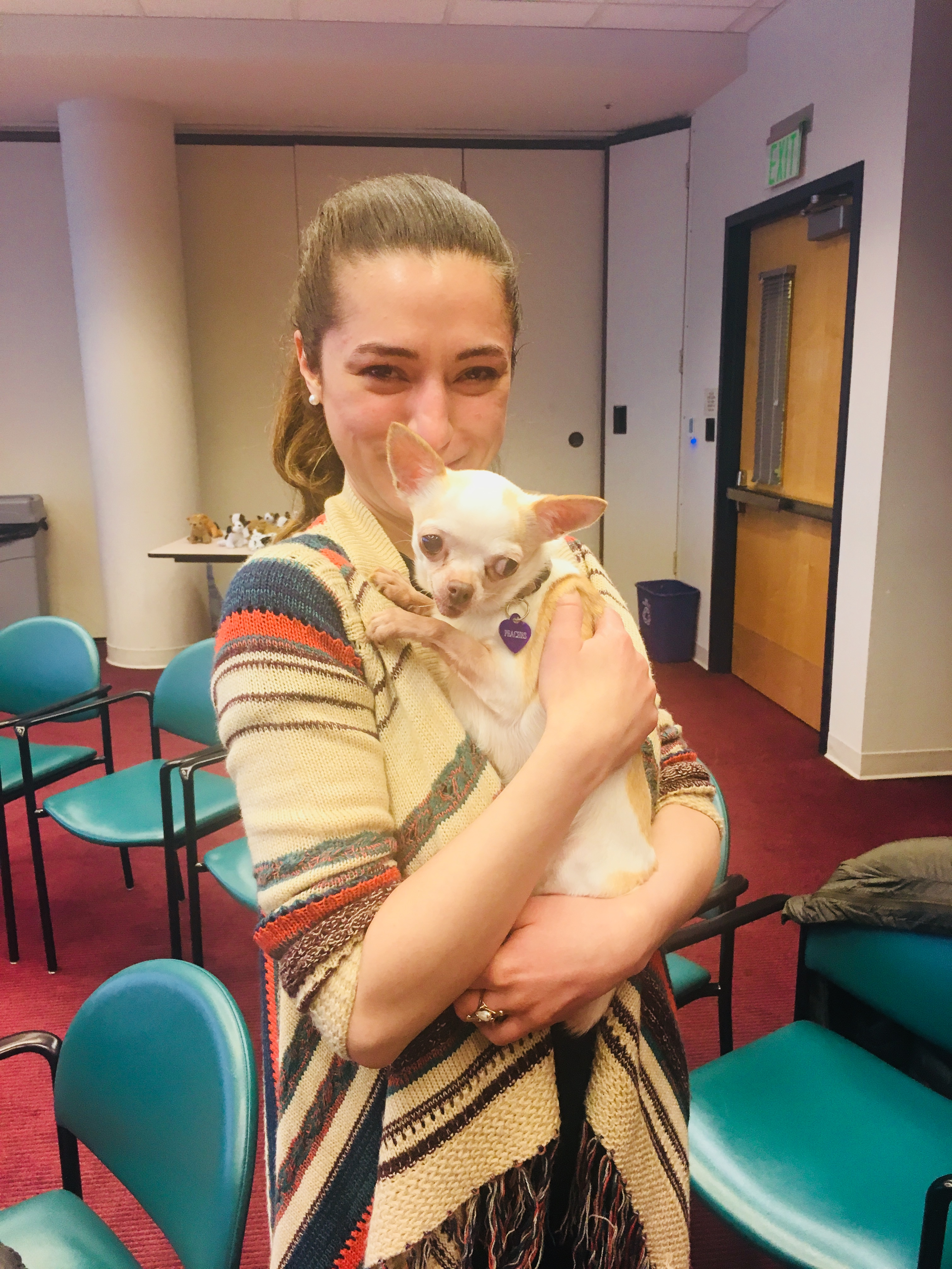 WTBBL Assistant Manager Alycia cuddles a rescue Chihuahua at the Special Pet Meet & Greet Event on May 5, 2018.